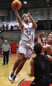 Chisholm's Cade Balenti shoots over Perry defenders during the first round of the Wheat Capital Classic Basketball Tournament Thursday, January 2020 at Chisholm High School. (Billy Hefton / Enid Nwes & Eagle)