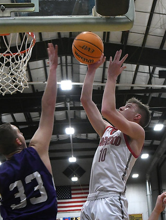 Ringwood's Jacob Briggs scores against Burlington's Gabe Stewart during the championship game of the Cherokee Strip Conference Basketball Tournament Saturday, 25, 2020 at the Chisholm Trail Expo Center. (Billy Hefton / Enid News & Eagle)