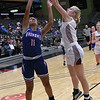 Pioneer's Kennedy Cassody gets a hand on the shot of Waukomis' Hope Gilliland during the first day of the 96th Skeltur Conference Basketball Tournament at the Stride Bank Center Thursday, January 23, 2020. (Billy Hefton / Enid News & Eagle)