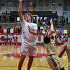 Chisholm's Tanner Jones gets behind Woodward's Zaine Farley for a shot during the second day of the Wheat Capital Classic Basketball Tournament Friday, January 10, 2020 at Chisholm High School. (Billy Hefton / Enid Nwes & Eagle)