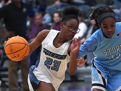 Enid's Mya Edwards drives towards the basket against OKC Storm's Jaynae Eddens Tuesday, January 14, 2020 at the Stride Bank Center. (Billy Hefton / Enid News & Eagle)