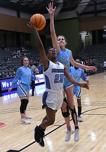 Enid's Mya Edwards gets by OKC Storm's Haylee Webber Tuesday, January 14, 2020 at the Stride Bank Center. (Billy Hefton / Enid News & Eagle)