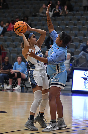 Enid's Lanie Goins gets pressured by OKC Storm's Maddi Callahan Tuesday, January 14, 2020 at the Stride Bank Center. (Billy Hefton / Enid News & Eagle)