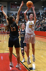 Alva's Lexie Raihm shoots over Kingfisher's Melody Wilfong during the finals of the Wheat Capital Basketball Tournament Saturday, January 11, 2020 at Chisholm High School. (Billy Hefton / Enid News & Eagle)