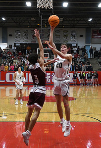 Kingfisher's Jarret Birdwell shoots over Perry's Caleb Fortney during the finals of the Wheat Capital Basketball Tournament Saturday, January 11, 2020 at Chisholm High School. (Billy Hefton / Enid News & Eagle)