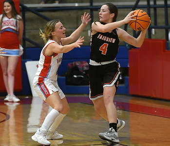 Chisholm's Regi Pasby pressures Fairview's Kenzie Case during the first round of the Wheat Capital Classic Basketball Tournament Thursday, January 2020 at Chisholm High School. (Billy Hefton / Enid Nwes & Eagle)