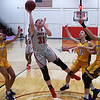 NOC Enid's Lauren Wade puts up a shot surrounded by Dodge City's Jayleen Cole, Xenia Cavalle and Madison Gissendanner Saturday, January 4, 2020 at the NOC Mabee Center. (Billy Hefton / Enid News & Eagle)