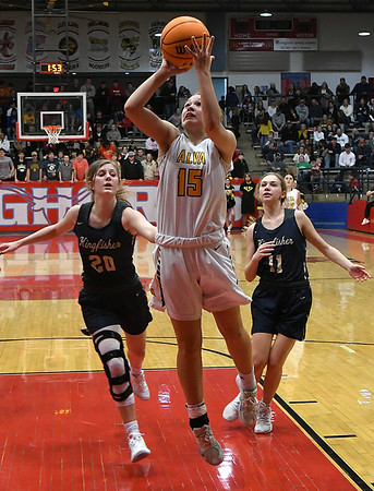 Alva's Brooke Perez gets behind Kingfisher's Britt Taylor and Kina Frost for a basket during the finals of the Wheat Capital Basketball Tournament Saturday, January 11, 2020 at Chisholm High School. (Billy Hefton / Enid News & Eagle)