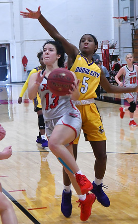 NOC Enid's Abbey Phibbs goes under Dodge City's Leroyeisha Thomas Saturday, January 4, 2020 at the NOC Mabee Center. (Billy Hefton / Enid News & Eagle)