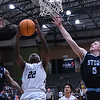 Enid's Sam Hill goes up between OKC Storm's Andrew Lewis and Cooper Peterson Tuesday, January 14, 2020 at the Stride Bank Center. (Billy Hefton / Enid News & Eagle)