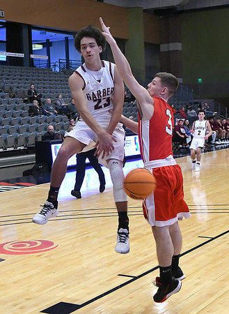 Garber's Daegan Vandiver passes the ball around Dover's Trinton Ritz during the first day of the 96th Skeltur Conference Basketball Tournament at the Stride Bank Center Thursday, January 23, 2020. (Billy Hefton / Enid News & Eagle)
