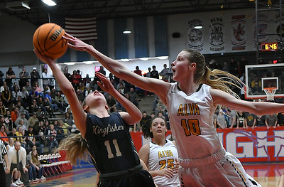 Alva's Lexie Raihm gets a hand on the shot of Kingfisher's Kina Frost during the finals of the Wheat Capital Basketball Tournament Saturday, January 11, 2020 at Chisholm High School. (Billy Hefton / Enid News & Eagle)