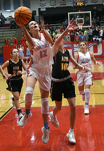 Chisholm's Courtney Petersen gets by Alva's Lexie Raihm for a basket during the semi-finals of the Wheat Capital Classic Basketball Tournament Friday, January 10, 2020 at Chisholm High School. (Billy Hefton / Enid Nwes & Eagle)