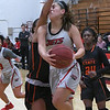 NOC Enid's Shelby Black goes to the basket against Connors State's Jasyn Taylor Thursday, January 16, 2020 at the NOC Mabee Center. (Billy Hefton / Enid News & Eagle)