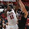 NOC Enid's Ikenna Okeke goes up against Mid American Christian University's Trey Johnson Monday, January 6, 2020 at the NOC Mabee Center. (Billy Hefton / Enid News & Eagle)