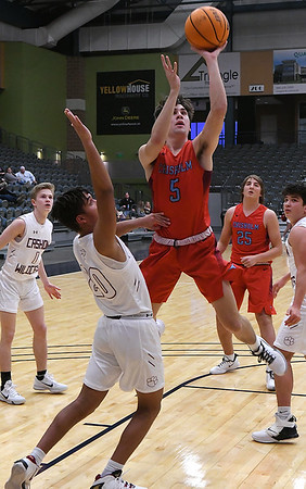 Chisholm's Parker Warnock gets off a shot against Cashion's Vance Raney during the Downtown Basketball Festival Friday, January 31, 2020 at the Stride Bank Center. (Billy Hefton / Enid News & Eagle)