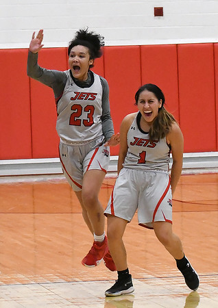 NOC Enid's Tanara Combs and Shelby Black celebrate the Jets win over Connors State Thursday, January 16, 2020 at the NOC Mabee Center. (Billy Hefton / Enid News & Eagle)