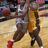 NOC Enid's Tonijah Fortune drives to the basket against Dodge City's Bridgett Fairbank Saturday, January 4, 2020 at the NOC Mabee Center. (Billy Hefton / Enid News & Eagle)