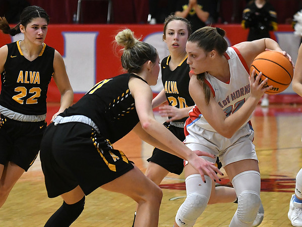 Chisholm's Tatum Sefcik is trapped by Alva's Payton Jones, Jaedyn Williams and Chloe Durkee during the semi-finals of the Wheat Capital Classic Basketball Tournament Friday, January 10, 2020 at Chisholm High School. (Billy Hefton / Enid Nwes & Eagle)