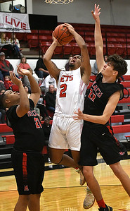 NOC Enid's ZQuestyn Lucky goes up for a shot between Mid American Christian University's Tinsley Payne and Trey Johnson Monday, January 6, 2020 at the NOC Mabee Center. (Billy Hefton / Enid News & Eagle)
