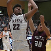 Garber's Ty Chester scores a basket against Pioneer's Kevin Noel during the championship game of the 96th Skeltur Conference Basketball Tournament Saturday, 25, 2020 at the Stride Bank Center. (Billy Hefton / Enid News & Eagle)