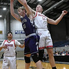 Ringwood's Aaron Baker and Burlington's Stanley Klippenstein compete for a rebound during the championship game of the Cherokee Strip Conference Basketball Tournament Saturday, 25, 2020 at the Chisholm Trail Expo Center. (Billy Hefton / Enid News & Eagle)