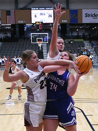 Brynlee Cue of Waukomis is fouled by Pioneer's Aspen Stephens during the first day of the 96th Skeltur Conference Basketball Tournament at the Stride Bank Center Thursday, January 23, 2020. (Billy Hefton / Enid News & Eagle)