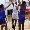 NOC Enid's Ikenna Okeke shoots over Murray State's Andre Washington and Jaylen Thomas at the NOC Mabee Center Thursday, January 23, 2020. (Billy Hefton / Enid News & Eagle)