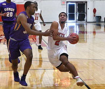 NOC Enid's Questyn Lucky drives to the basket against Dodge City's Myron Washington Saturday, January 4, 2020 at the NOC Mabee Center. (Billy Hefton / Enid News & Eagle)