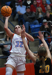 Chisholm's Tatum Sefcik shoots over Alva's Jaedyn Williams during the semi-finals of the Wheat Capital Classic Basketball Tournament Friday, January 10, 2020 at Chisholm High School. (Billy Hefton / Enid Nwes & Eagle)