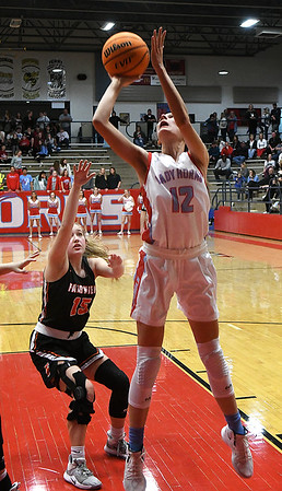 Chisholm's Courtney Petersen scores against Fairview's Macy Barton during the first round of the Wheat Capital Classic Basketball Tournament Thursday, January 2020 at Chisholm High School. (Billy Hefton / Enid Nwes & Eagle)