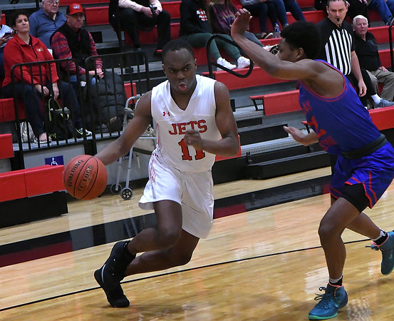 NOC Enid's Ikenna Okeke drives towards the basket against Murray State's Kyle Murray at the NOC Mabee Center Thursday, January 23, 2020. (Billy Hefton / Enid News & Eagle)