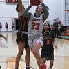 NOC Enid's Tanara Combs goes to the basket against Connors State's Jasyn Taylor Thursday, January 16, 2020 at the NOC Mabee Center. (Billy Hefton / Enid News & Eagle)