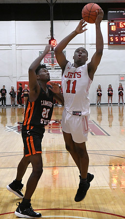 NOC Enid's Ikenna Okeke puts up a shot in the lane against Connors State's Jordan Graham Thursday, January 16, 2020 at the NOC Mabee Center. (Billy Hefton / Enid News & Eagle)