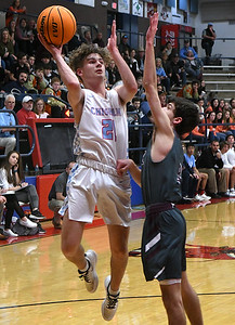 Chisholm's Hunter Combs shoots over Perry's Caleb Fortney during the first round of the Wheat Capital Classic Basketball Tournament Thursday, January 2020 at Chisholm High School. (Billy Hefton / Enid Nwes & Eagle)