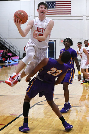 NOC Enid's Andrew O'Brien drives to the basket against Dodge City's Deatrick Pashell Saturday, January 4, 2020 at the NOC Mabee Center. (Billy Hefton / Enid News & Eagle)