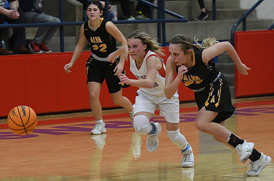 Chisholm's Regi Pasby and Alva's Jaedyn Willians got after a loose ball during the semi-finals of the Wheat Capital Classic Basketball Tournament Friday, January 10, 2020 at Chisholm High School. (Billy Hefton / Enid Nwes & Eagle)