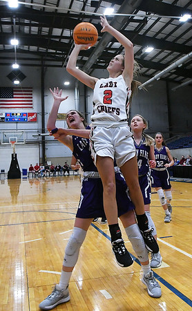 Cherokee's Lizzy Webster scores against Burlington's Kayli Stewart during the semi-finals of the Cherokee Strip Conference Tournament Friday, January 24, 2020 at the Chisholm Trail Expo Center. (Billy Hefton / Enid News & Eagle)