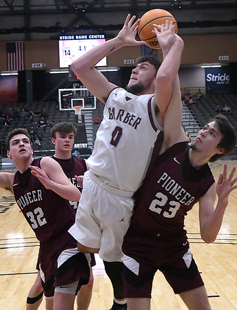Garber's Sha Martin and Pioneer's Jacob Henry tussel for a rebound during the championship game of the 96th Skeltur Conference Basketball Tournament Saturday, 25, 2020 at the Stride Bank Center. (Billy Hefton / Enid News & Eagle)