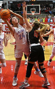 Chisholm's Tatum Long muscles the ball up against Fairview's Macy Barton during the first round of the Wheat Capital Classic Basketball Tournament Thursday, January 2020 at Chisholm High School. (Billy Hefton / Enid Nwes & Eagle)