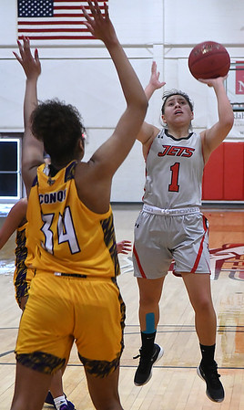 NOC Enid's Shelby Black shoots over Dodge City's Alana Busby-Dunphy Saturday, January 4, 2020 at the NOC Mabee Center. (Billy Hefton / Enid News & Eagle)