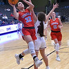 Chisholm's Tatum Sefcik gets by Cashion's Kaitin Taylor during the Downtown Basketball Festival Friday, January 31, 2020 at the Stride Bank Center. (Billy Hefton / Enid News & Eagle)