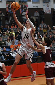 Kingfisher's Bijan Cortes gets by Perry's Caleb Fortney for a basket during the finals of the Wheat Capital Basketball Tournament Saturday, January 11, 2020 at Chisholm High School. (Billy Hefton / Enid News & Eagle)