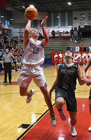 Chisholm's Will Staerkei shoots over Perry's Caden Hall during the first round of the Wheat Capital Classic Basketball Tournament Thursday, January 2020 at Chisholm High School. (Billy Hefton / Enid Nwes & Eagle)