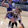 Garber's Alyssa Johnson drives around Waukomis' Taylor Moody during the championship game of the 96th Skeltur Conference Basketball Tournament Saturday, 25, 2020 at the Stride Bank Center. (Billy Hefton / Enid News & Eagle)