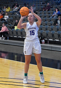 Drummond's Emma Spring shoots a three point shot against Dover during the opening round of the 97th Skeltur Conference Basketball Tournament Thursday, January 21, 2021 at the Stride Bank Center. (Billy Hefton / Endi News & Eagle)