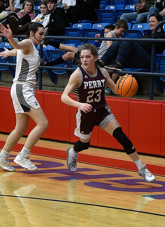 Perry's Maebry Shields drives by Kingfisher's Allison Green during the championship game of the Wheat Capital Tournament Saturday, January 9, 2021 at Chisholm High School. (Billy Hefton / Endi News & Eagle)