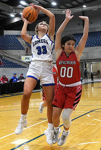 Lomega's Emma Duffy puts up a shot against Ringwood's Ana Resandiz during a semi-final gmae of the Cherokee Strip Conference Tournament Friday, January 22, 2021 at the Chisholm Trail Expo Center. (Billy Hefton / Enid News & Eagle)