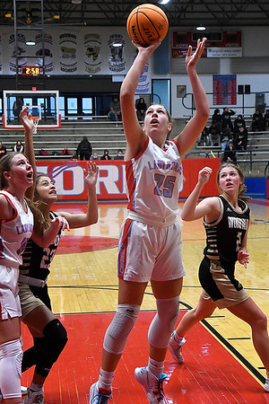 Chisholm's Grace Winter puts up a shot against Woodward during the first round of the Wheat Capital Tournament Thursday, January 7, 2021 at Chisholm High School. (Billy Hefton / Enid News & Eagle)