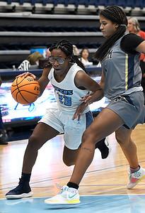 Enid's Mya Edwards drives towards the basket against OKC Storm's Madison Callahan at Enid High School Tuesday, January 19, 2021. (Billy Hefton / Endi News & Eagle)